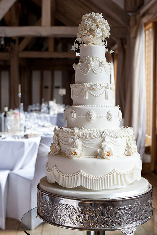 white six tier cake with sugar icing details