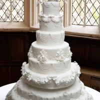 all white wedding cake with beautiful piping and sugar icing details